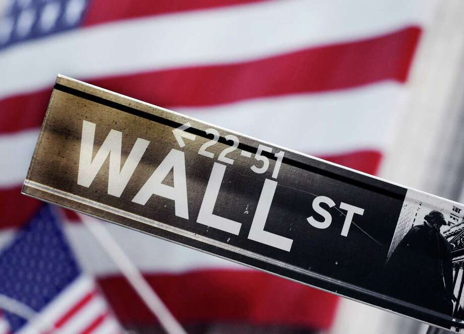 FILE - This Aug. 9, 2011 file photo shows a Wall Street street sign near the New York Stock Exchange, in New York. Stocks are opening mostly higher Tuesday, April 28, 2015, as the health care sector rebounds from a slump the day before. (AP Photo/Mark Lennihan, File) ORG XMIT: NYBZ117 Photo: Mark Lennihan / AP