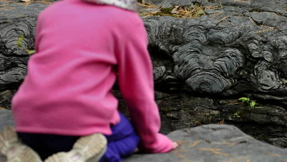 A student checks out one of the formations at the Petrified Sea Gardens in Saratoga Springs in October 2004.