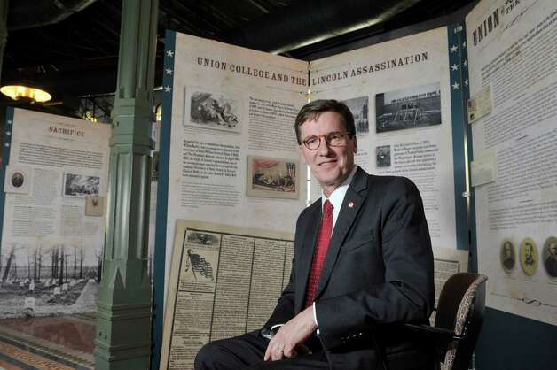 Stephen Ainlay, president of Union College, poses for a photograph by some of the panels that make up the  exhibit entitled Profound & Poignant: Union College Connections to the Civil War Era which is on display inside the Nott Memorial on Tuesday, April 28, 2015, at Union College in Schenectady, N.Y.  (Paul Buckowski / Times Union) Photo: PAUL BUCKOWSKI / 00031597A