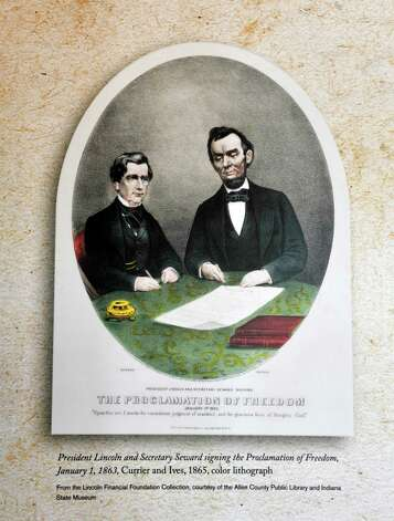 An Illustration of President Lincoln and Secretary William Seward, Union class of 1820, signing the Proclamation of Freedom is part of the exhibit entitled Profound & Poignant: Union College Connections to the Civil War Era which is on display inside the Nott Memorial on Tuesday, April 28, 2015, at Union College in Schenectady, N.Y.  (Paul Buckowski / Times Union) Photo: PAUL BUCKOWSKI / 00031597A