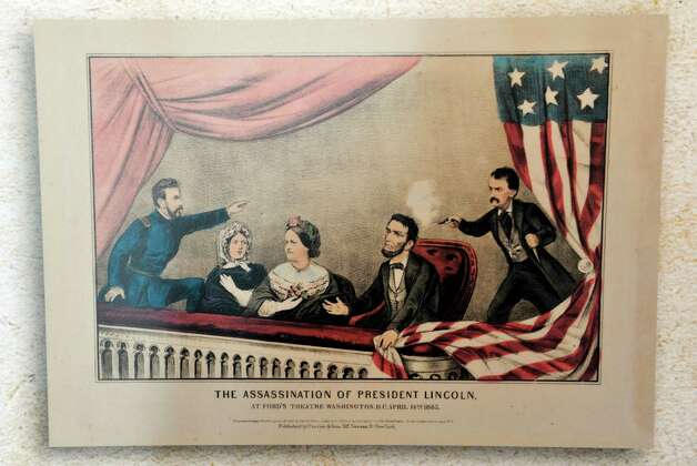 A hand-colored lithograph depicts the assassination of President Lincoln is part of the exhibit entitled Profound & Poignant: Union College Connections to the Civil War Era which is on display inside the Nott Memorial on Tuesday, April 28, 2015, at Union College in Schenectady, N.Y.  The lithograph shows Major Henry Rathbone, far left, Union class of 1857, who was there when John Wilkes Booth shot President Lincoln.  (Paul Buckowski / Times Union) Photo: PAUL BUCKOWSKI / 00031597A