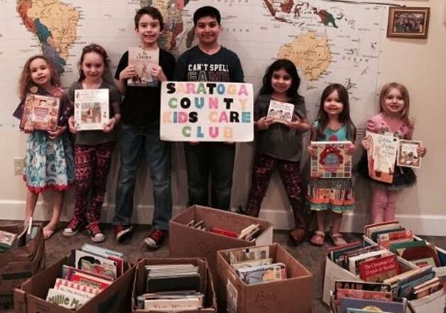 Saratoga County Club Members counting and sorting books, rom left: Ariel Jones, Isabella Fuda, Jonathan Jones, Aydin Sajjad, Ariana Sajjad, Joanna Jones and Giulianna Fuda. Missing from photo: Hannah Vedder and Wesley Vedder)
