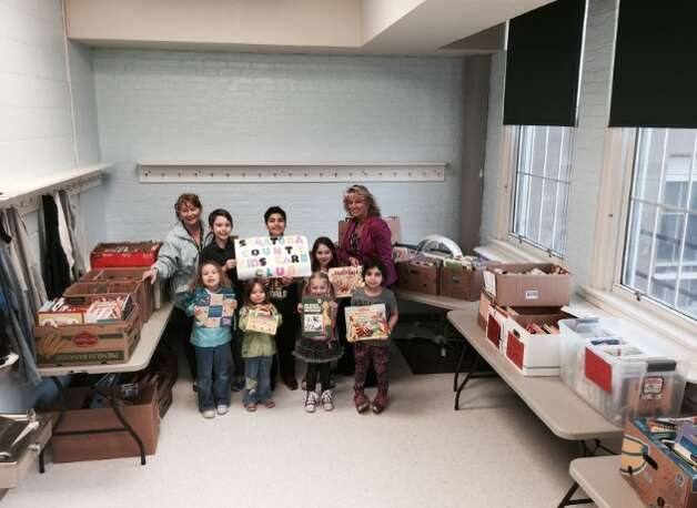 Malta Avenue Elementary School on April 27, 2015 during the Donation Drop Off for HeadStart and all four Ballston Spa Elementary Schools. (From left to right back row: Helen Thompson, Jonathan Jones, Aydin Sajjad, Isabella Fuda and Principal Sharon D'Agostino. Front row: Ariel Jones, Joanna Jones, Giulianna Fuda and Ariana Sajjad)