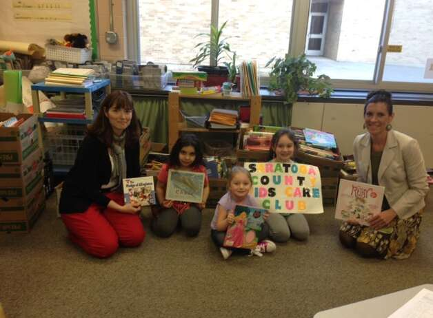 : Dorothy Nolan Elementary School on April 23, 2015 during the donation drop off for their Traveling Library (From left to right: Mrs. Cook, Ariana Sajjad, Giulianna Fuda, Isabella Fuda and Dana Bush)