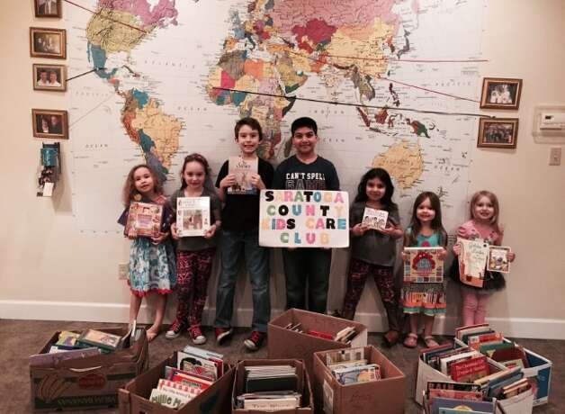 Saratoga County Club Members counting and sorting books (From left to right: Ariel Jones, Isabella Fuda, Jonathan Jones, Aydin Sajjad, Ariana Sajjad, Joanna Jones and Giulianna Fuda. Missing from photo: Hannah Vedder and Wesley Vedder)