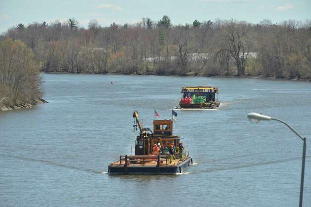 New York State Canal Corporation employees work on the Mohawk River as they set navigation buoys for the Erie Canal just below Lock 7 on Tuesday, April 28, 2015, in Niskayuna, N.Y.   Opening day of the canal system is scheduled for May 8th.   (Paul Buckowski / Times Union) Photo: PAUL BUCKOWSKI / 00031632A