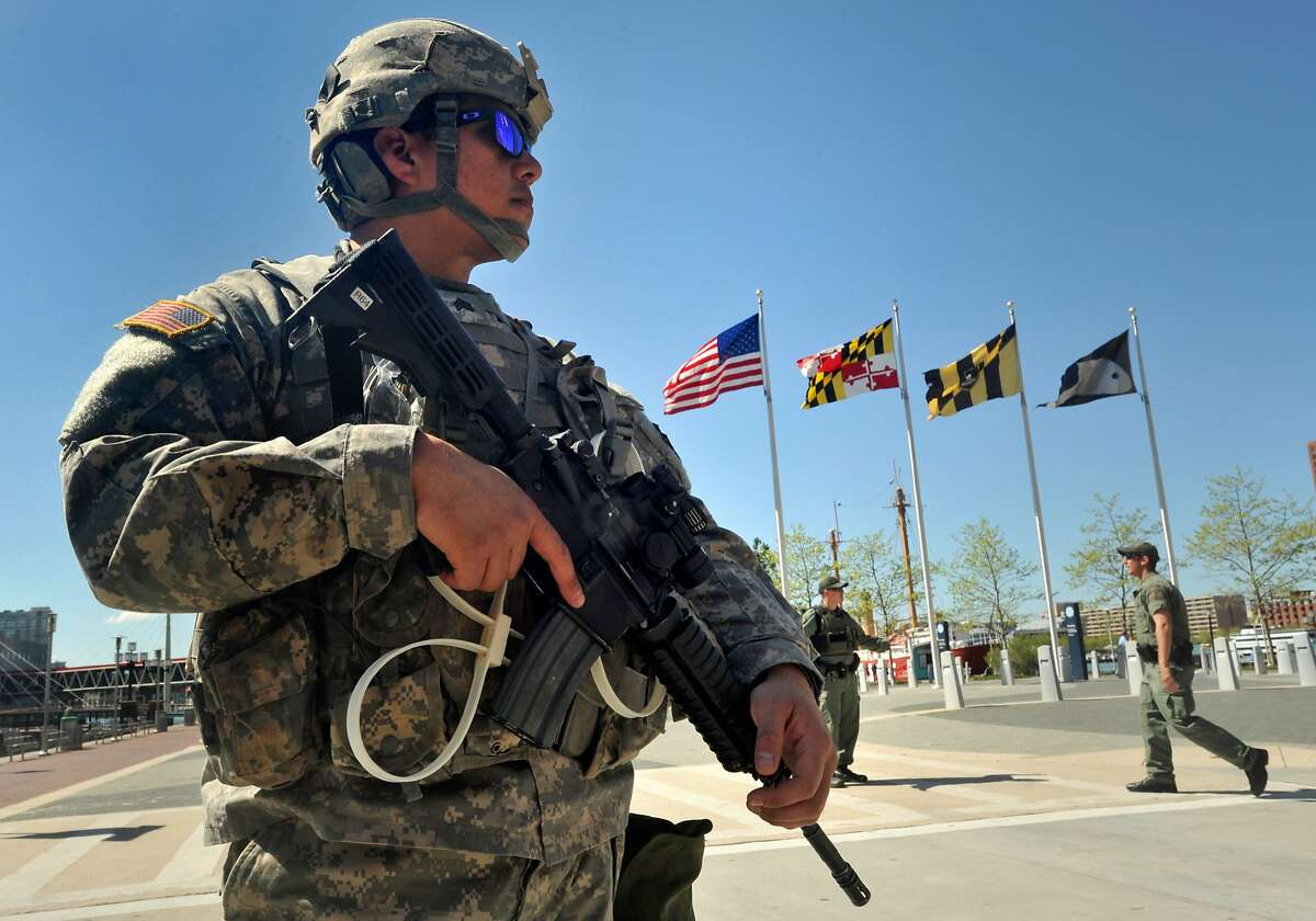 The 175th Infantry of the Maryland National Guard is stationed along Pratt Street at the Inner Harbor on Tuesday, April 28, 2015, in Baltimore. (Amy Davis/Baltimore Sun/TNS)