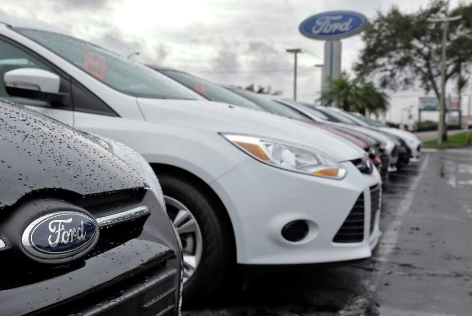 Ford cars are on display at a dealership in Brandon, Fla.  Ford Motor Co.'s earnings came in below analysts' expectations, but Ford expects a rebound. Photo: Chris O'Meara, STF / AP
