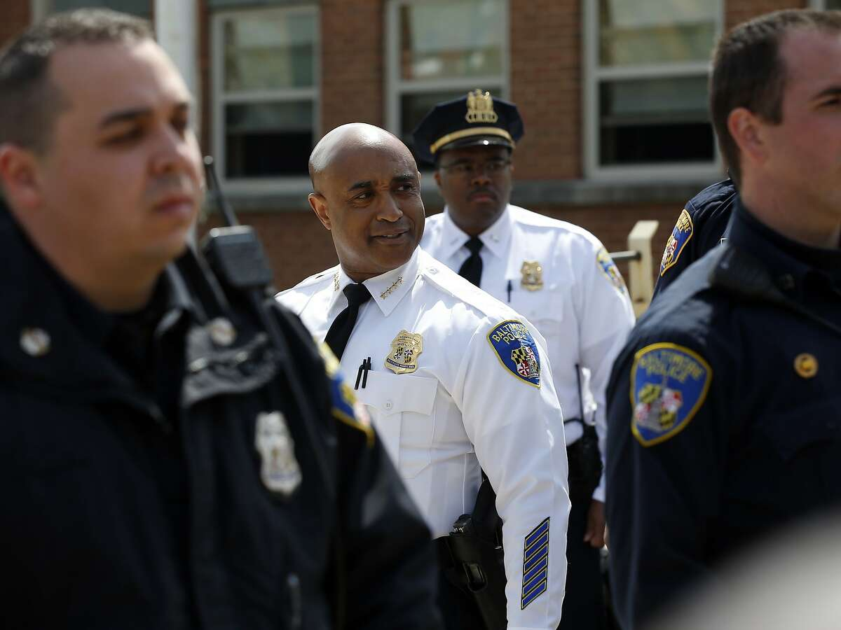 Baltimore Superintendent of police Anthony Batts, center, pauses to look at the crowd at the Western District station, before a march to City Hall for Freddie Gray, Saturday, April 25, 2015 in Baltimore. Gray died from spinal injuries about a week after he was arrested and transported in a police van. (AP Photo/Alex Brandon)