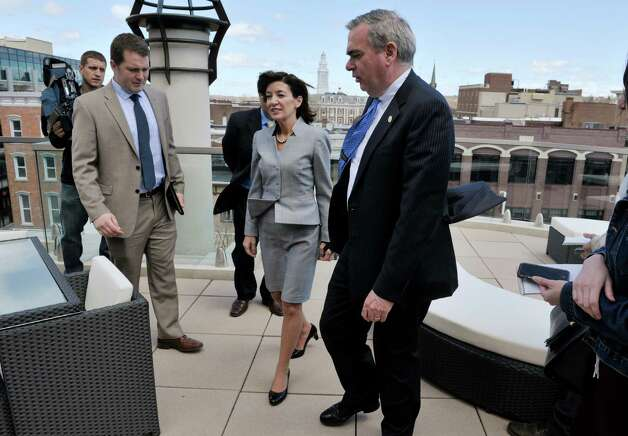 Lieutenant Governor Kathy Hochul talks with Schenectady Mayor Gary McCarthy, on an outside patio on a top floor at the business Transfinder  on Tuesday, April 28, 2015, in Schenectady, N.Y.  Lieutenant Governor Hochul was given a tour of downtown Schenectady businesses to see how state programs are being used by businesses.      (Paul Buckowski / Times Union) Photo: PAUL BUCKOWSKI / 00031625A