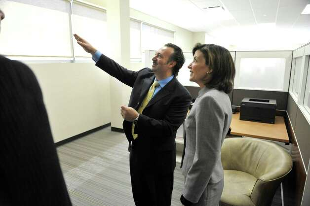 Antonio Civitella, left, president and CEO of Transfinder, gives a tour of his business to Lieutenant Governor Kathy Hochul on Tuesday, April 28, 2015, in Schenectady, N.Y.  Lieutenant Governor Hochul and Schenectady Mayor Gary McCarthy took  a tour of downtown Schenectady businesses to see how state programs are being used by businesses.      (Paul Buckowski / Times Union) Photo: PAUL BUCKOWSKI / 00031625A