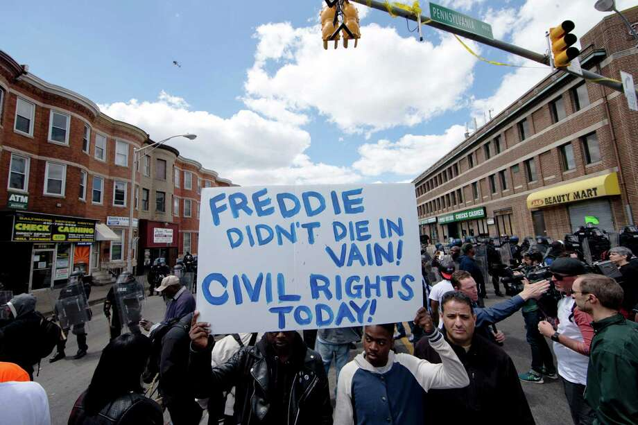 """Our great African American President hasn't exactly had a positive impact on the thugs who are so happily and openly destroying Baltimore!""Source: Twitter Photo: Matt Rourke, STF / AP"