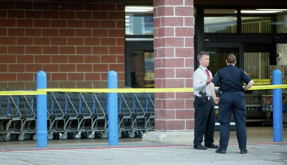 Houston Police officers investigate after a suspect stabbed a Houston Community College police officer at a Wal-Mart in southwest Houston on Tuesday Photo: Cody Duty, Staff / © 2015 Houston Chronicle