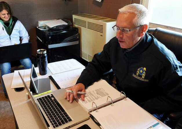 Trainer Todd Pletcher does his daily tracking of races at his barn area office at Churchill Downs Tuesday morning, April 28, 2015, in Louisville, Ky. The 141st running of The Kentucky Derby starts Saturday.  (Skip Dickstein/Times Union) Photo: SKIP DICKSTEIN