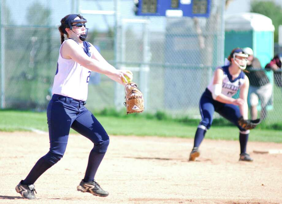 Staples pitcher Emily Lustbader fires a pitch during a game against Warde on Tuesday. The Wreckers lost 5-4. Photo: Ryan Lacey/Staff Photo / Westport News Contributed