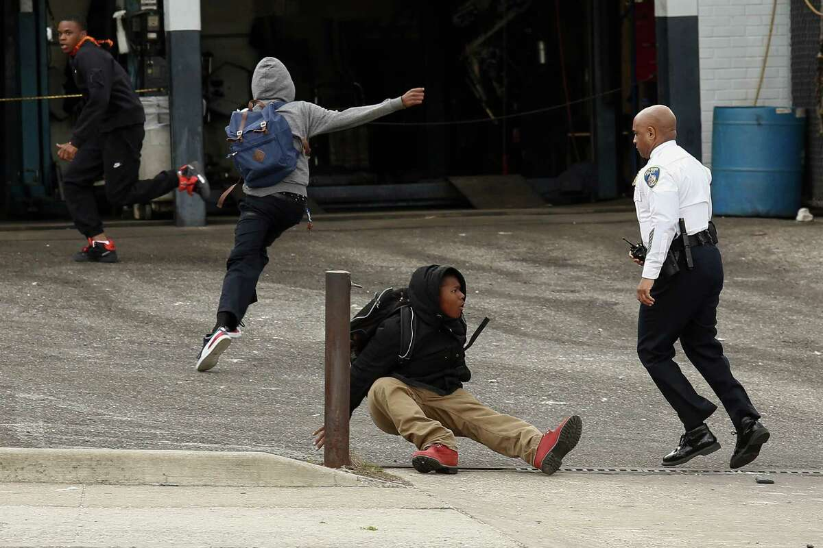 Baltimore Police Commissioner Anthony Batts chases away protesters in a parking lot on Reisterstown Road near Mowdamin Mall, April 27, 2015 in Baltimore, Maryland. The funeral service for Freddie Gray, who died last week while in Baltimore Police custody, was held on Monday morning.