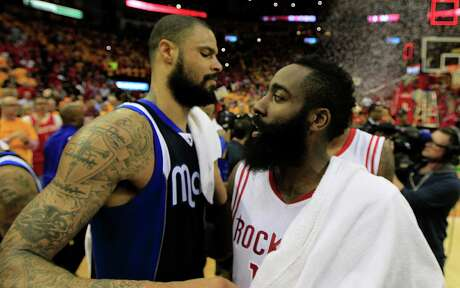 Dallas Mavericks center Tyson Chandler left, and Houston Rockets guard James Harden after the Rockets defeated the Dallas Mavericks in Game 5 in the first round of NBA basketball playoffs at the Toyota Center Tuesday, April 28, 2015, in Houston.