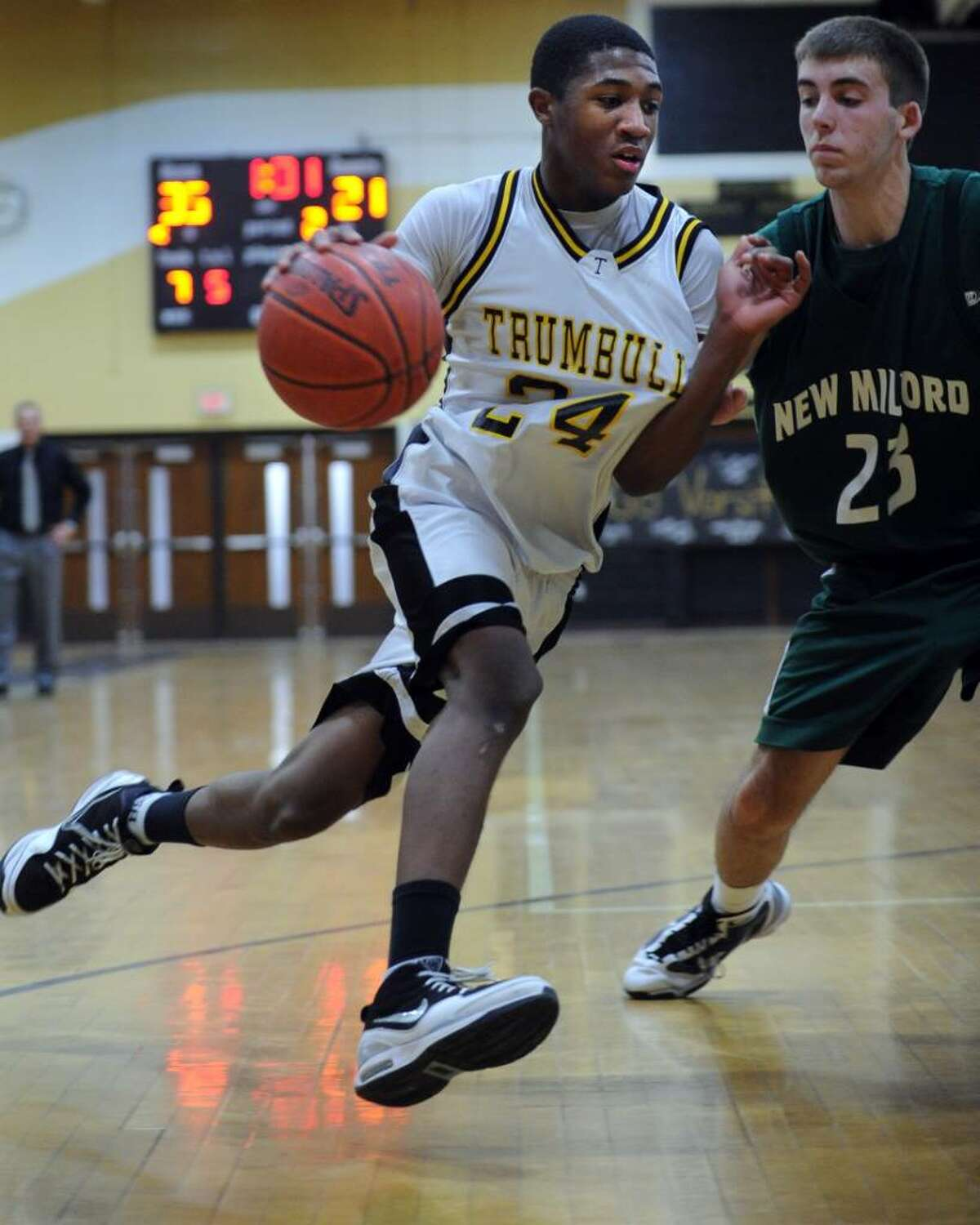 Trumbull's Julian Sanders drives to the net during the Class LL first round state tournament game against New Milford Tuesday Mar. 9, 2010 at Trumbull High School.