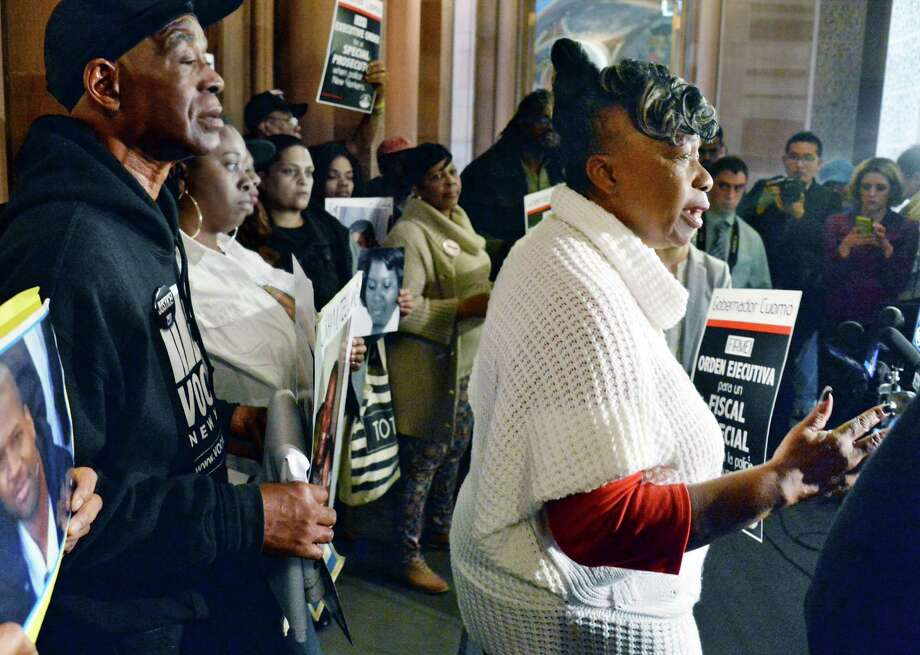 Gwen Carr, right, mother of Eric Garner speaks during a news conference by families of people killed by police who demand that governor Cuomo issue an executive order for a special prosecutor Tuesday, April 28, 2015, outside the governor's offices  in Albany, NY.  (John Carl D'Annibale / Times Union) Photo: John Carl D'Annibale / 00031623A