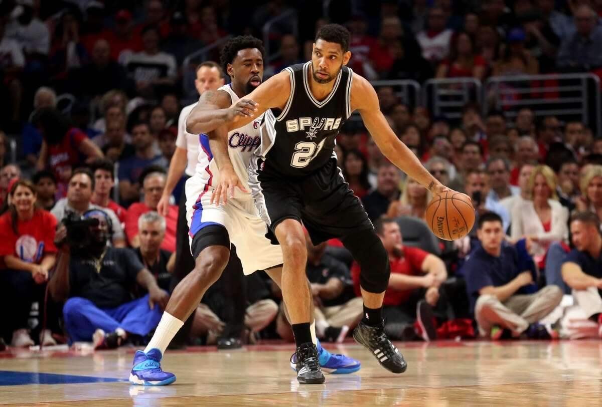 LOS ANGELES, CA - APRIL 28: Tim Duncan #21 of the San Antonio Spurs controls the ball against DeAndre Jordan #6 of the Los Angeles Clippers during Game Five of the Western Conference quarterfinals of the 2015 NBA Playoffs at Staples Center on April 28, 2015 in Los Angeles, California. NOTE TO USER: User expressly acknowledges and agrees that, by downloading and or using this photograph, User is consenting to the terms and conditions of the Getty Images License Agreement. (Photo by Stephen Dunn/Getty Images)