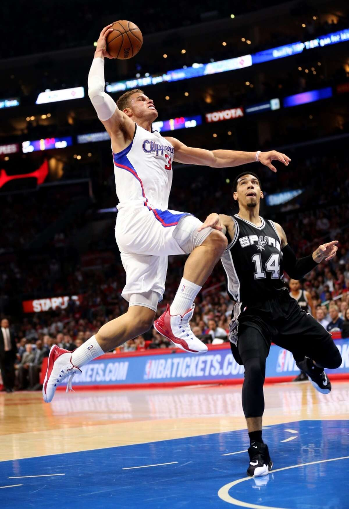 LOS ANGELES, CA - APRIL 28: Blake Griffin #32 of the Los Angeles Clippers dunks over Danny Green #14 of the San Antonio Spurs during Game Five of the Western Conference quarterfinals of the 2015 NBA Playoffs at Staples Center on April 28, 2015 in Los Angeles, California. NOTE TO USER: User expressly acknowledges and agrees that, by downloading and or using this photograph, User is consenting to the terms and conditions of the Getty Images License Agreement. (Photo by Stephen Dunn/Getty Images)