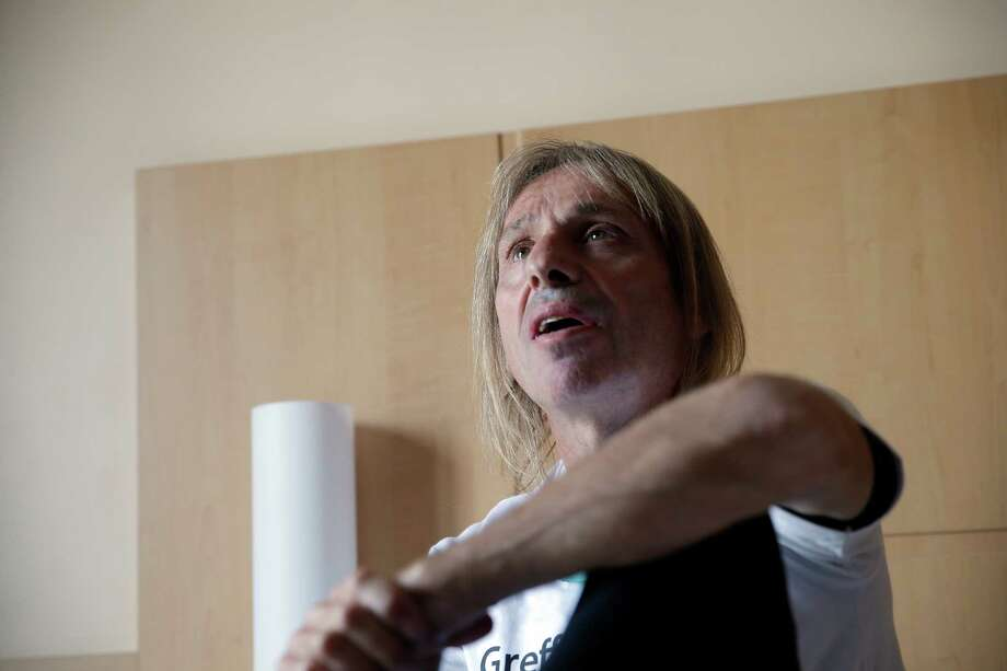 Alain Robert, also known as the French Spiderman, answers reporters before climbing  the Montparnasse tower a 210-metre (689 ft) office skyscraper located in the Montparnasse area of Paris, France, Tuesday, April 28, 2015. Robert decided to climb in solidarity with the victims of the Saturday's earthquake in Nepal.  Photo: Christophe Ena, Associated Press / AP