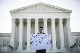 WASHINGTON, DC - APRIL 28: Same-sex marriage supporter Ryan Aquilina, of Washington, DC, holds a sign near the Supreme Court, April 28, 2015 in Washington, DC. On Tuesday the Supreme Court will hear arguments concerning whether same-sex marriage is a constitutional right, with decisions expected in June. (Drew Angerer/Getty Images) *** BESTPIX ***