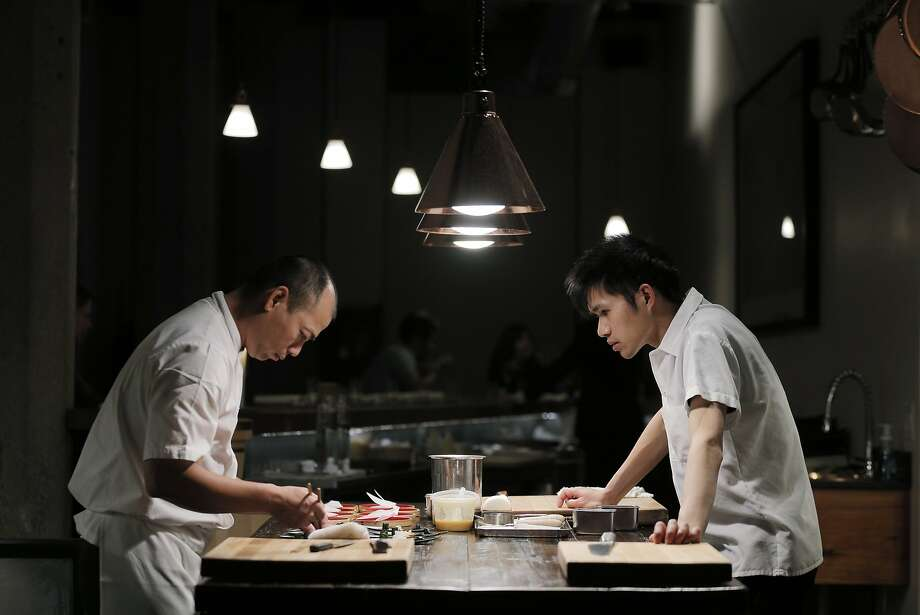 Jiro Lin, left, prepares sushi dinner for a small group at Saison in San Francisco in 2015. Photo: Carlos Avila Gonzalez, The Chronicle