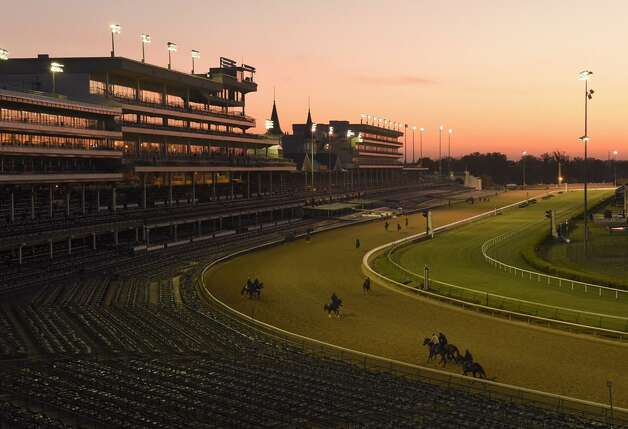 The sun rises over Churchill Downs in Louisville, Kent., on Wednesday. The track will host the 141st running of the Kentucky Derby on Saturday. (Skip Dickstein / Times Union)