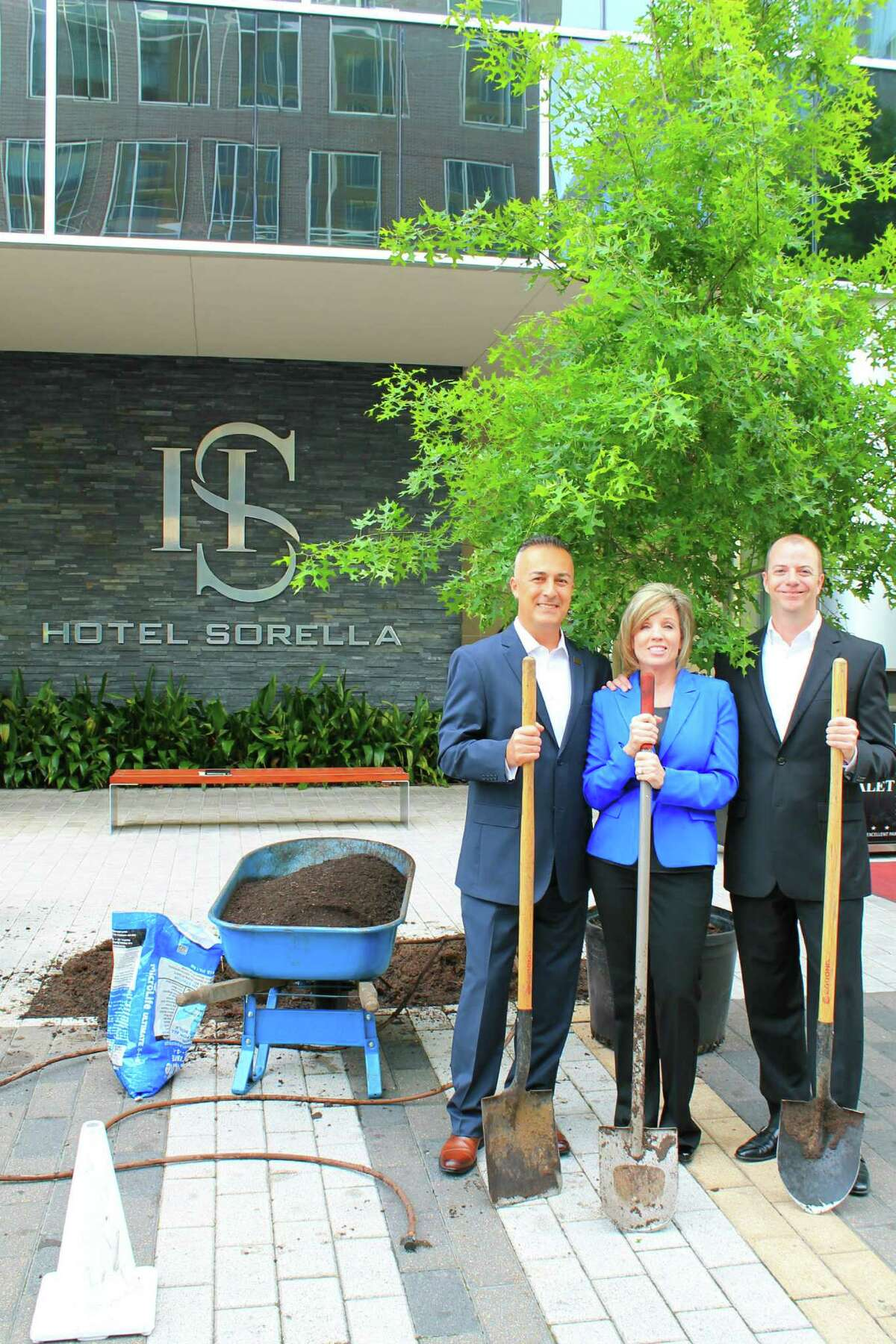 CityCentre's Hotel Sorella now has a new tree. Safet Dokara, left, director of operations; Nancy Alonzo, director of sales and marketing, and Ryan Gullion, general manager, celebrated Earth Day by planting a 14-foot red oak tree at the entrance to the property April 22. This effort kicks off an annual initiative to plant a tree each Earth Day within the CityCentre district.
