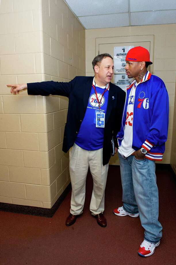 Former Philadelphia 76ers CEO Adam Aron (L) and Allen Iverson (R) speak at the Wells Fargo Center in Philadelphia, Pennsylvania in this file photo. Aron, a hospitality executive who was recently installed as CEO of Stamford-based Starwood Hotels and Resorts, is considering a sale of the massive hotel chain. Photo: Jeff Fusco, Getty Images For Reebok / 2012 Getty Images
