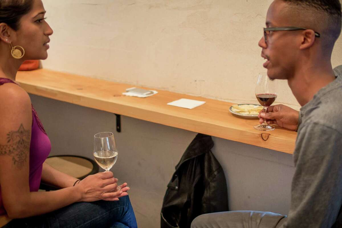 Cameron Drake has a glass wine with RoseMarie Maliekel at Birba in San Francisco, Calif., on April 28th, 2015.