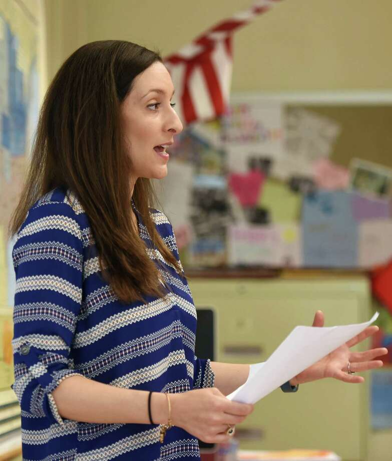 Diana Willie teaches one of her eighth-grade social studies classes at Western Middle School in Greenwich, Conn. Wednesday, April 29, 2015.  Willie was awarded one of the six Greenwich School District Distinguished Teacher Awards for 2015. Photo: Tyler Sizemore / Greenwich Time