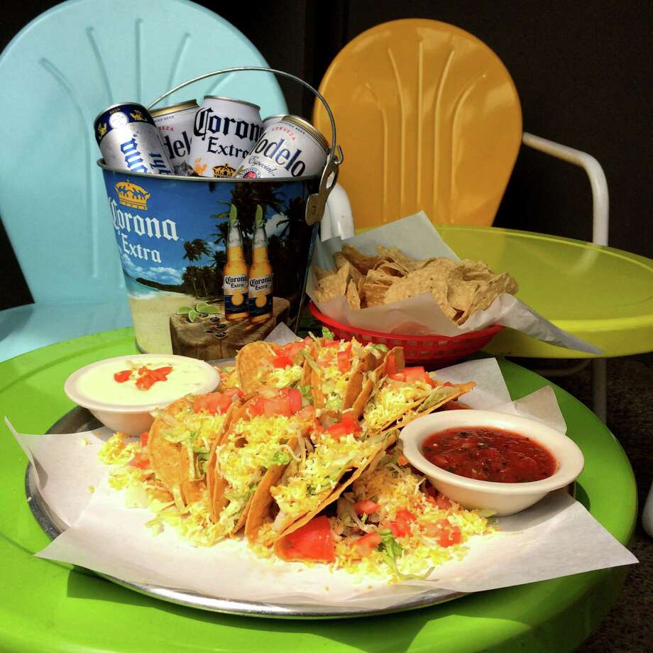 Doc's MotorworksThis Montrose spot has one of the best deals we've seen. On May 5, you can get a platter of tacos, chips, salsa, queso and a bucket filled with five beers (Corona, Corona Light or Modelo) for $20. 1303 Westheimer, 713-521-3627