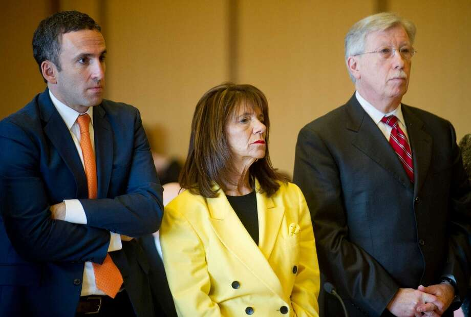 Stamford High School Principal Donna Valentine stands with her attorney, Mark Sherman, left, and Assistant Principal Roth Nordin's attorney Fred O'Brien, right, as she appears in State Superior Court in Stamford, Conn., on Thursday, November 13, 2014. Photo: Lindsay Perry