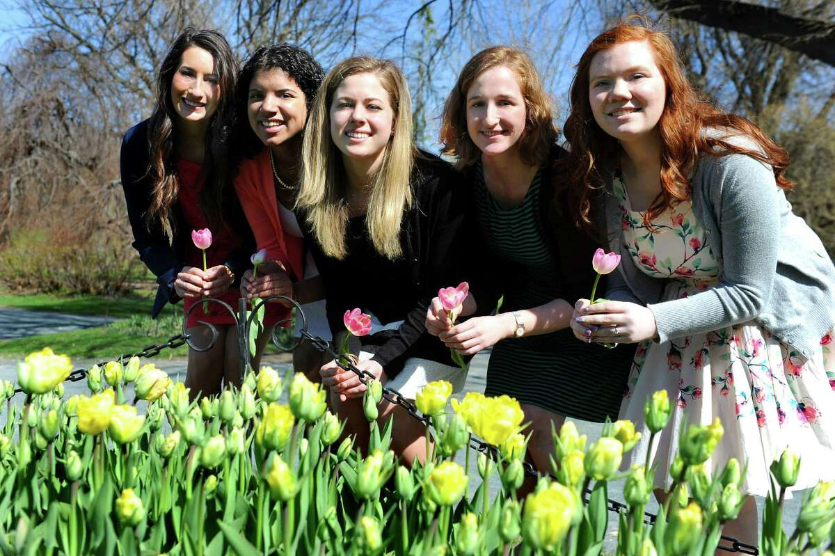 Tulip Queen finalists pose after a news conference on Wednesday, April 29, 2015, at Washington Park in Albany, N.Y. From left are Alexandra Cronin, 22, of Selkirk, Morgan Elizabeth Heyward, 18, of Albany, Jacqueline Murphy, 23, of Albany, Eva Petkanas, 22, of Albany and Sarah Wilamowski, 20, of Guilderland. (Cindy Schultz / Times Union)