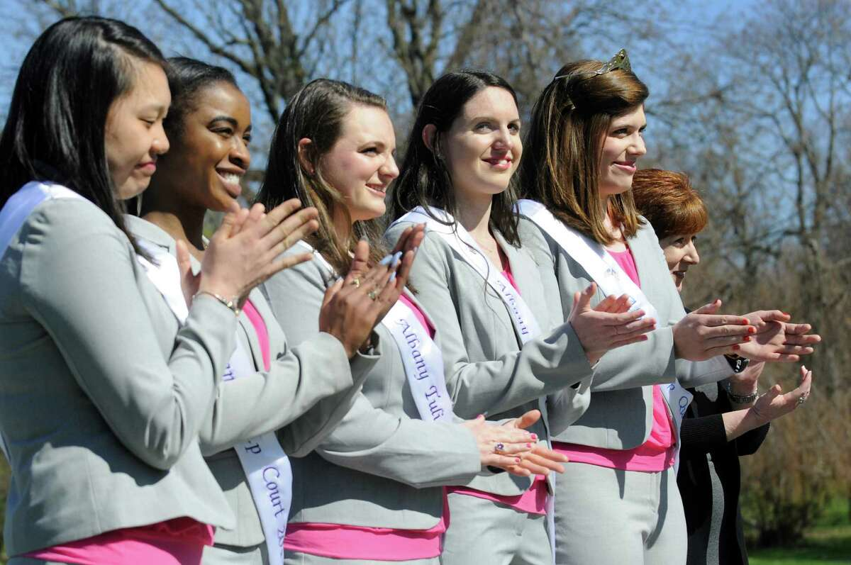 Mayor Kathy Sheehan, right, 2014 Tulip Queen Caitlin Whelan, second from right, and her court applaud the 2015 Tulip Queen finalists during a news conference on Wednesday, April 29, 2015, at Washington Park in Albany, N.Y. (Cindy Schultz / Times Union)