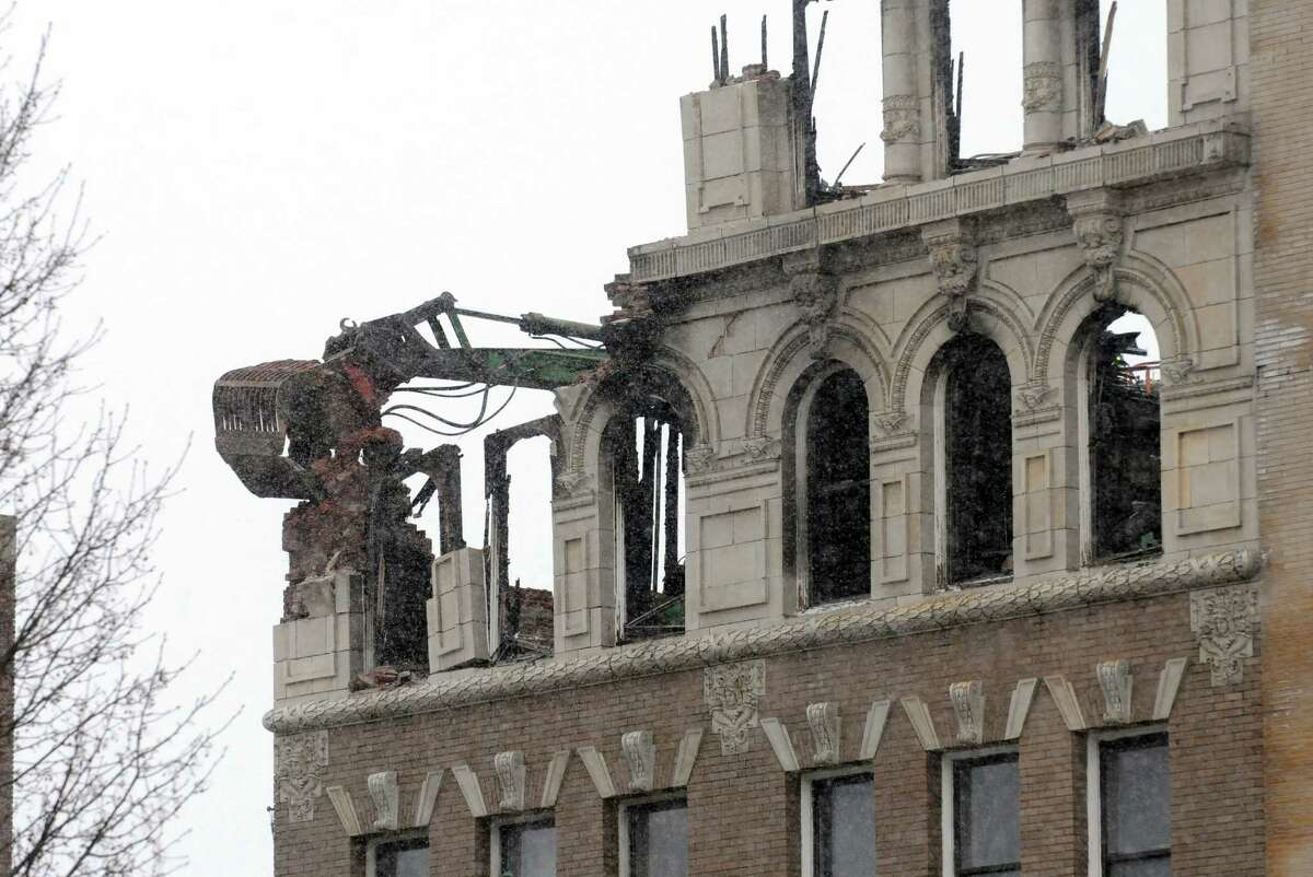 Demolition begins on the two Jay Street buildings destroyed by fire on Friday March 20, 2015 in Schenectady, N.Y. (Michael P. Farrell/Times Union) ORG XMIT: MER2015042413555832