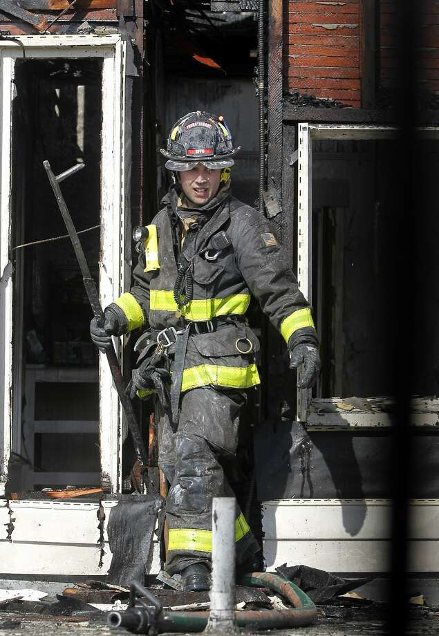 A firefighter emerges from the second floor of Liverpool Lil's bar and restaurant on Lyon Street after a 2-alarm blaze is extinguished in San Francisco, Calif. on Wednesday, April 29, 2015. Damage appeared to be largely limited to the second floor office area of the restaurant but arson investigators continue to search for the cause and origin of the fire. Photo: Paul Chinn, The Chronicle