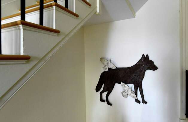"""Kiki Smith's """"Wolf with Birds III""""River Crossings,"""" an artwork hanging at the Thomas Cole historic home Friday April 24, 2015 in Catskill, N.Y. (Skip Dickstein/Times Union) Photo: SKIP DICKSTEIN / 00031457A"""