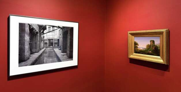 """Gregory Crewdson's untitled photograph, left, opposite Thomas Cole's """"Tower by Moonlight"""" in the """"River Crossings"""" show art work at the Thomas Cole museum Friday April 24, 2015 in Catskill, N.Y.        (Skip Dickstein/Times Union) Photo: SKIP DICKSTEIN / 00031457A"""