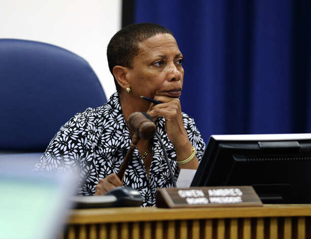 President Gwen Ambres uses her gavel to call for order after the audience cheered comments made by Mike Neil during Thursday evening's budget meeting. The Beaumont Independent School District board of trustees met Thursday evening to discuss the district's budget. Photo taken Thursday 6/5/14 Jake Daniels/@JakeD_in_SETX Photo: Jake Daniels / ©2014 The Beaumont Enterprise/Jake Daniels
