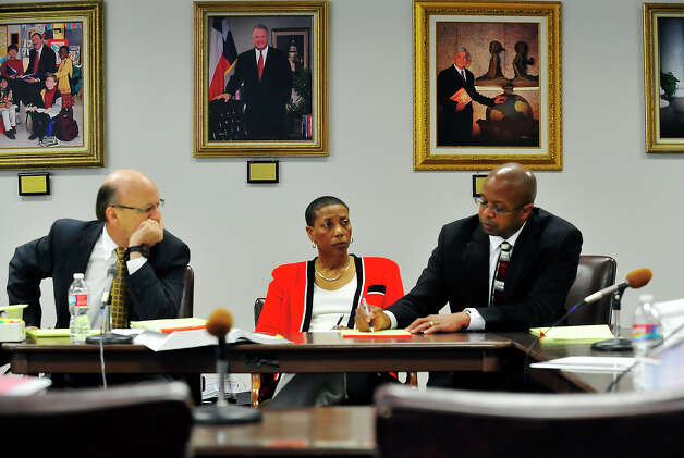 Beaumont ISD Superintendent Timothy Chargois pens a note to attorney Ron Rainey as board president Gwen Ambres looks on during Friday's hearing at the Texas Education Agency in Austin. Photo taken Friday 6/6/14 Brooke Crum/@broocrum Photo: Brooke Crum / ©2014 The Beaumont Enterprise/Jake Daniels