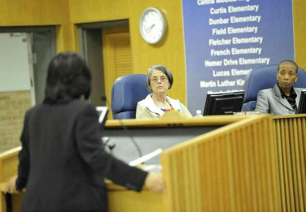 Beaumont Independent School Board Trustees Janice Brassard, left, and Gwen Ambres, right, listen as the school attorney, Melody Chappell, far left, addresses them    Dave Ryan/The Enterprise Photo: Dave Ryan