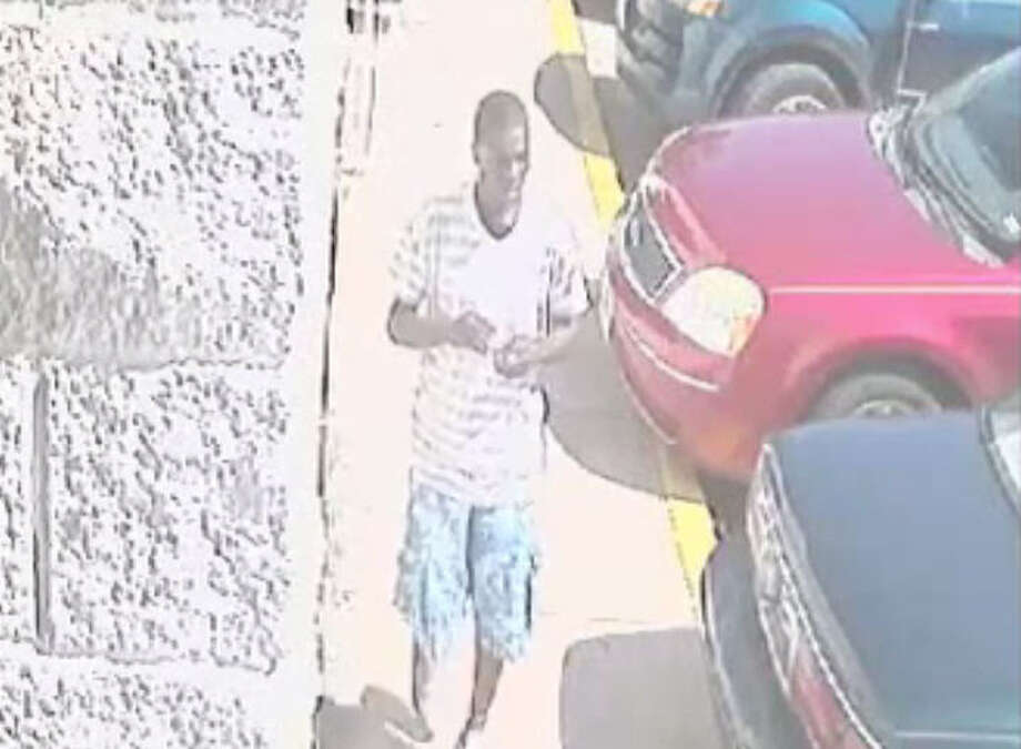 A young suspect is caught on tape apparently stealing an iPad from a 2-year-old who was playing with it outside a Houston laundromat. Photo: Houston Police Department