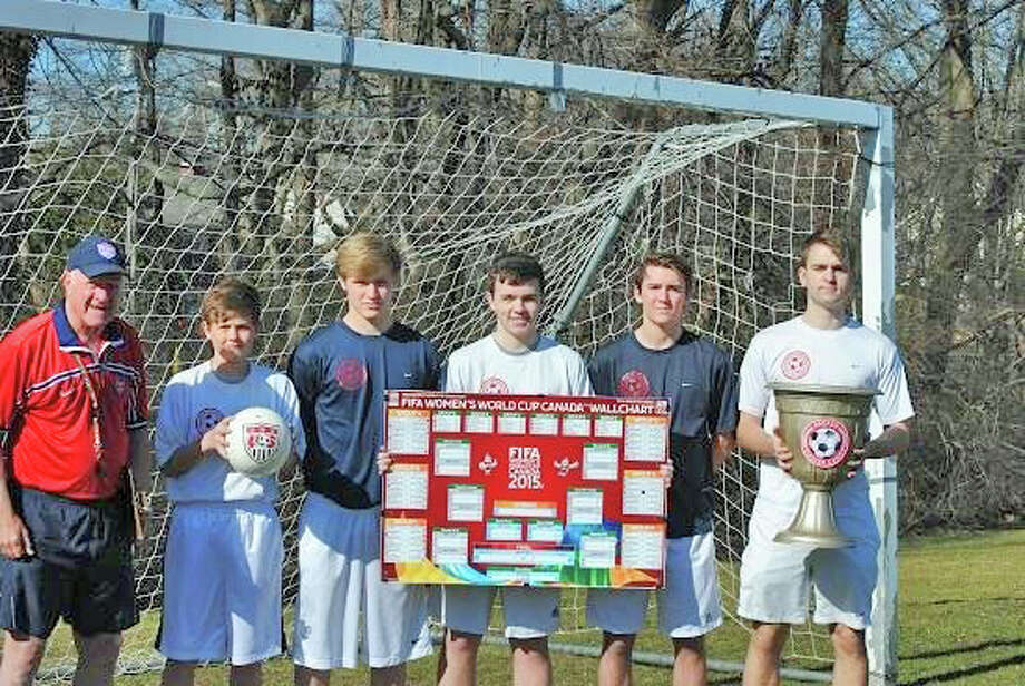 Pictured with the 2015 FIFA Women's World Cup Tournament Chart, along with the Packer Soccer Camp World Cup, in anticipation of following the Women's World Cup Matches at the tournament which coincides with the dates of the camp, to be held in Rowayton on June 22 - 26 and June 29 - July 3 are, from left,  Camp Director, Dick Packer, (Rowayton); Reilly Warble, CIT (Darien): Colby Scovel, Coach (Rowayton); Ian Anderson, Coach (Rowayton); Johann Nottebahn, Coach (Darien); Matt Hayes, Coach (Darien). Photo: Contirbuted, Contributed / Darien News