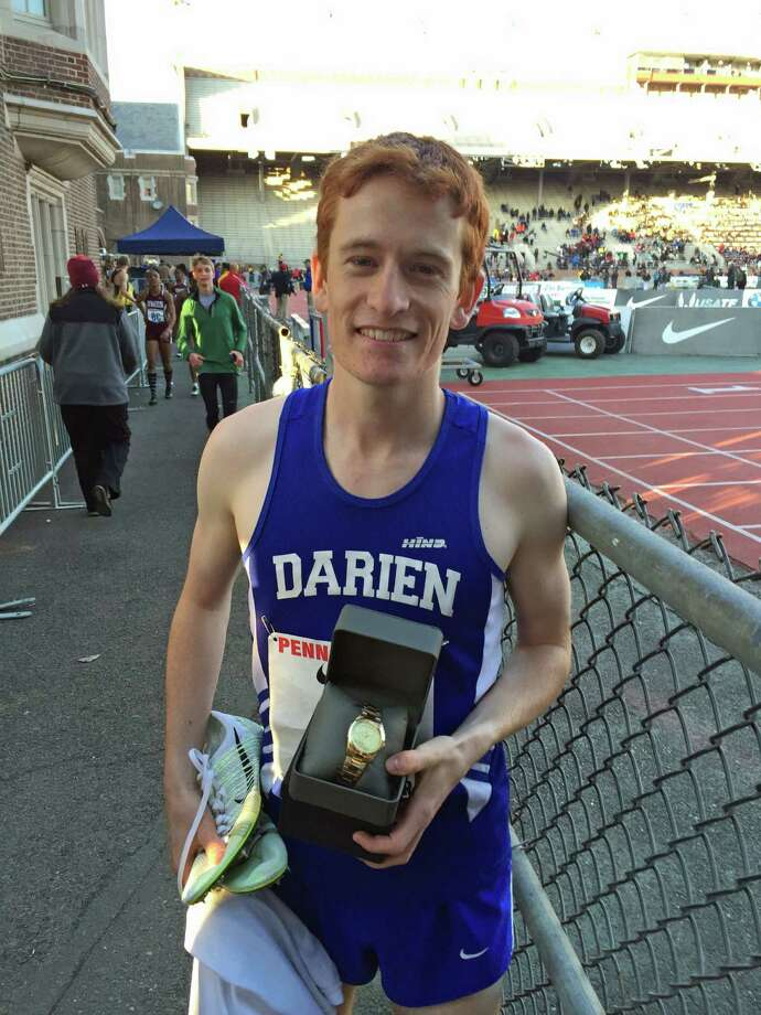 Alex Ostberg poses with a watch, his prize for a victory at the Penn Relays. Photo: Contirbuted, Contributed / Darien News