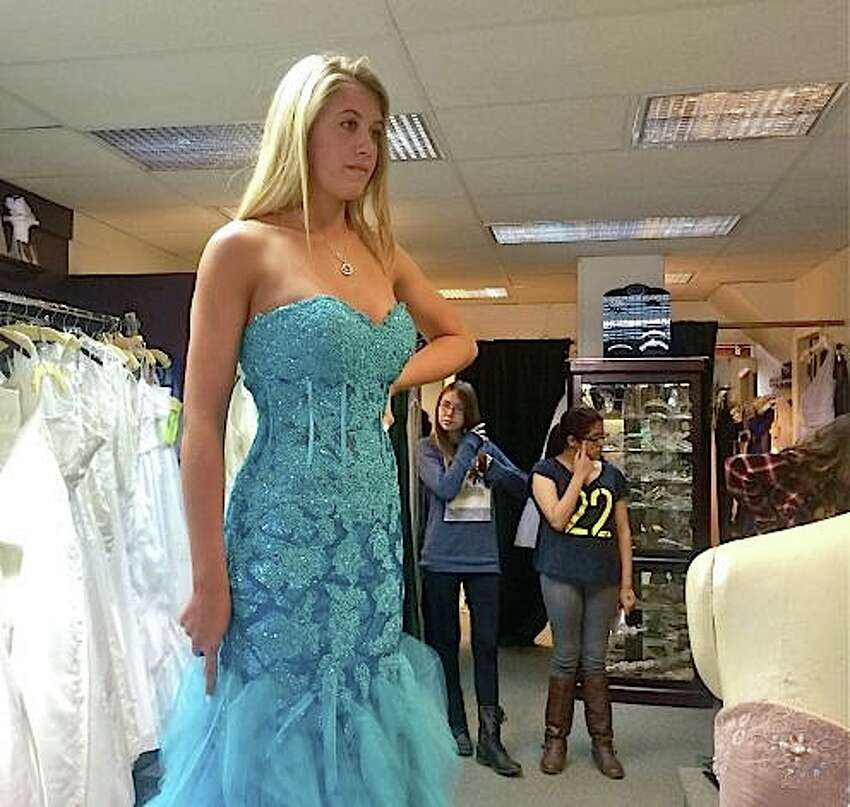 Occasions Bridal Shop - Bethel6 P T Barnum Square, Bethel, CT 06801 Pictured: Mandy Thompson tries on a mermaid-style gown at Occasions Bridal Shop in Bethel in 2014.