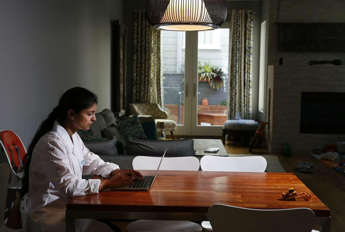 Dr. Raveena Rihal pictured in her home work environment where she works for Doctor on Demand April 29, 2015 in San Francisco, Calif. Rihal has a young son and likes the fact that she can work from home and still spend time with him throughout the day.