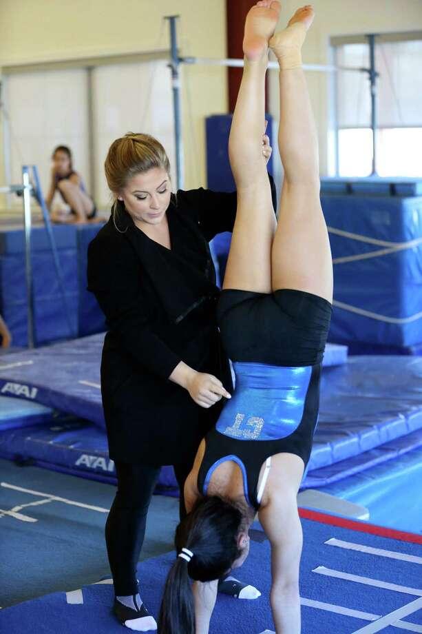 Shawn Johnson coaching Level 9 gymnast Adnerys de Jesus. Photo: Contirbuted, Contributed / Darien News